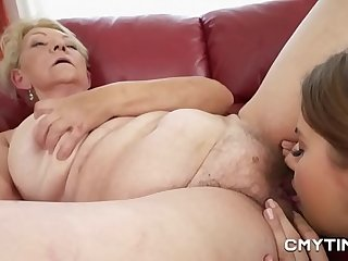 Teen cutie in lesbian porn with a GILF