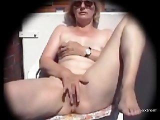 My mom masturbates on our balcony
