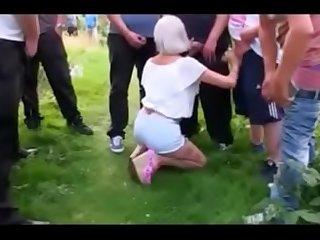 Hot GILF sucking many strangers dicks outdoor