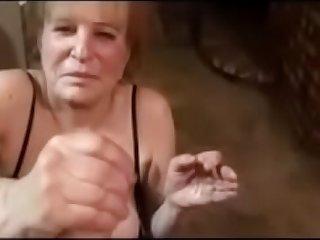 70 year old granny gives handjob and gets facial