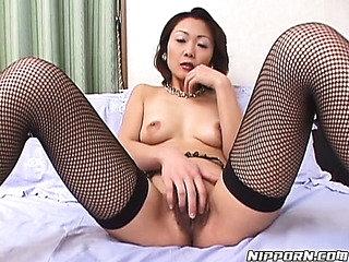 Older Japanese honey in fishnet nylons plays with her wet crack