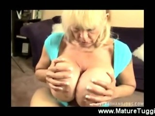 Mom squeezes dick between her monster boobs