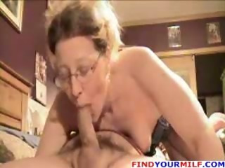 Amateur older wife gives blowjob and footjob