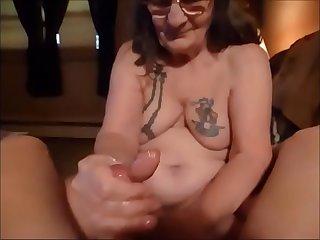 Granny with Glasses Giving a Nice Handjob